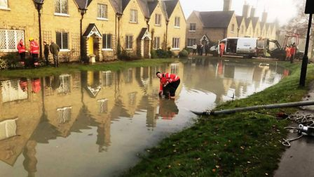 Fire crews dealing with the flood water in Wisbech Road, Thorney.