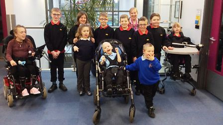 Caroline Rae (fourth right) with pupils from Meadowgate School.