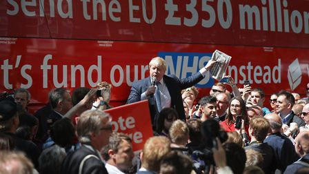 Boris Johnson addresses members of the public in front of the Vote Leave bus. (Photo by Christopher