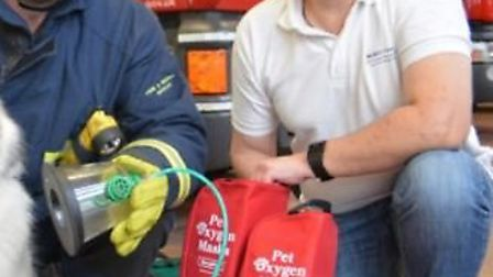 Firefighters with the Smoky Paws oxygen masks.