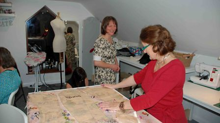 Carole Gallagher cutting out jacket lining, part of several garments Carole made in 2016.