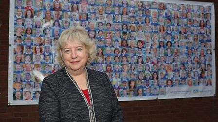 Dame Alison Peacock is leaving The Wroxham School after 14 years in front of her gift to the school.