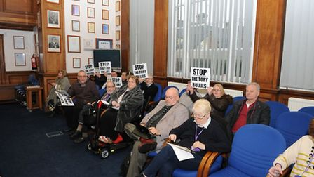 Early arrivals at a conduct committee hearing at Fenland Hall, March, on February 7 were protesters