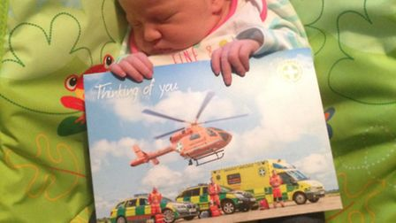 Daphne-Louise with the Thinking of You card sent to the family from Magpas Air Ambulance. PHOTO: Mag