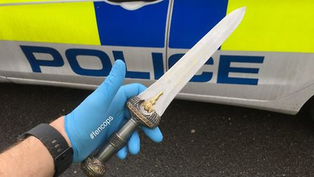 A man who threatened police officers with a knife that had a 21cm blade has been arrested in Wisbech