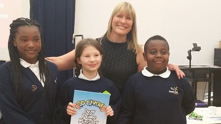 Left to right, Fifi, Grace, and Tinashe with Head Teacher, Mrs Massey.