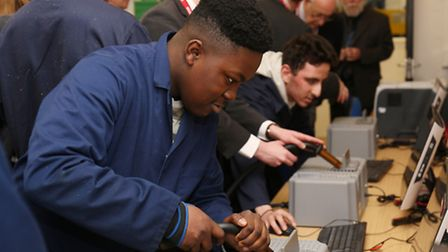 Students use the new virtual welding training equipment at the opening of the new welding training f