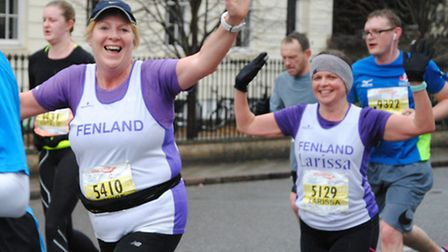 Fenland Running Club's Denise Griffin and Larissa Follen at the three-mile stage of the Cambridge Ci