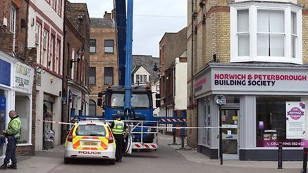Police have advised to avoid part of Wisbech after Hill Street was closed due to falling tiles from