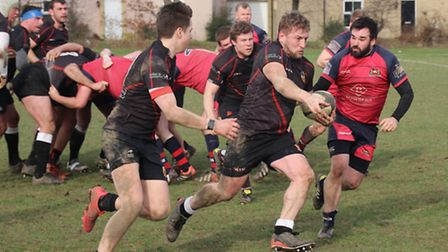 Oliver Mackett (in red) turned in a man-of-the-match performance as Wisbech as his side secured thei