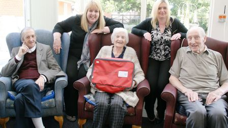 Lyncroft care home manager, Jan Davison (left) with a residents and their new red bag. The initiativ