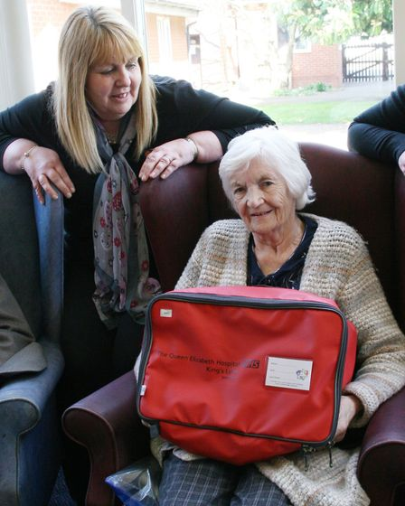 Lyncroft care home manager, Jan Davison with a resident and her new red bag.