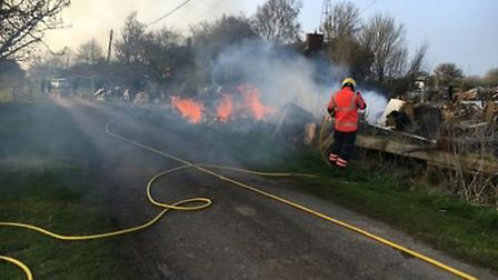 About 50 square metres of wood and pallets were found well alight close to a bungalow in Wisbech on