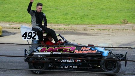 Wisbech racer Randal Lynn celebrates after becoming East Anglian Spedeworth champion in Great Yarmou