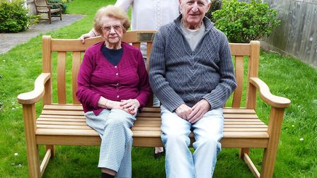 Langley Lodge residents Beryl Woods and Arthurt Edwards enjoy a sit on the care home's new bench, bo