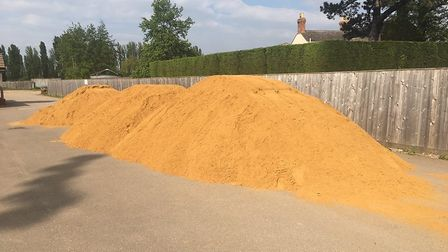 90 tonnes of sand is being spread on the pitch at Wisbech Town's Elgoods Fenland Stadium.