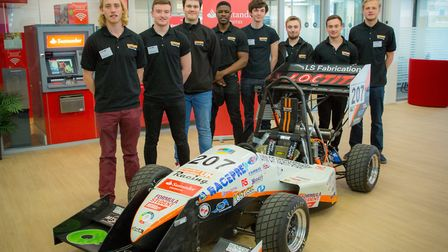 Engineering students with their racing car at the Santander event.