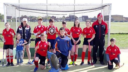 Wisbech Hockey Club under 14s show off their St. Ives Tournament trophy.
