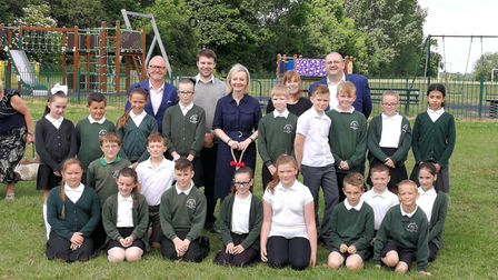 ear 5 pupils from Marshland St James primary school with MP Liz Truss at the cutting of the first so
