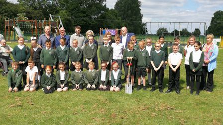 Year 5 pupils from Marshland St James primary school at the cutting of the first sod for the village