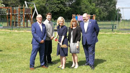 Ms Liz Truss MP with Lee Chapman, and Andy Stephens with Sue Askew and Brian Long pictured as she cu