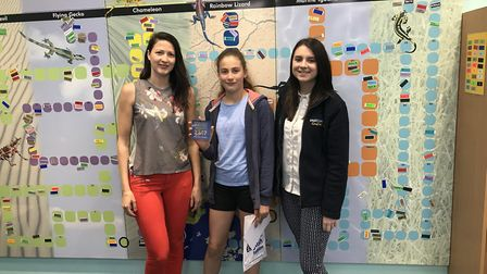 Prize-winning author Nicole Dodge, middle, with her mum Elena Dodge (left) and Explore Learning assi