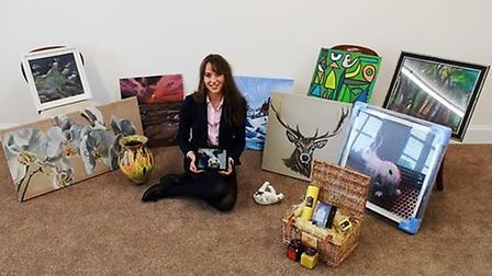 Katy Landle organises an art auction for a children's charity PHOTO: Wisbech Grammar School