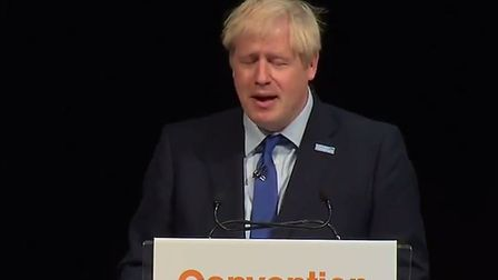 Boris Johnson was heckled by a man shouting 'get back to parliament' during the prime minister's spe