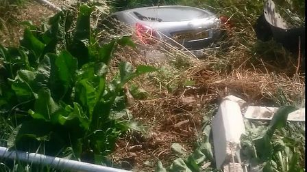 B1166 collision - a motorist has crashed into a Fenland dyke after a collision with a motor cyclist