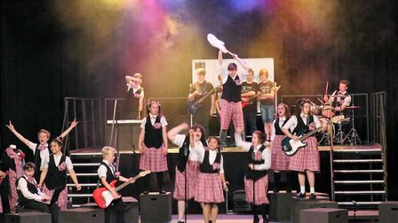 Students put on a barnstorming performance of School of Rock that rocked Thomas Clarkson Academy to