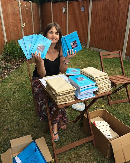 Bethany Harper with copies of her book.