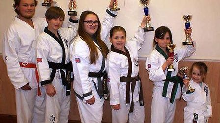 Nakita Davies, second from right, with one of her trophies