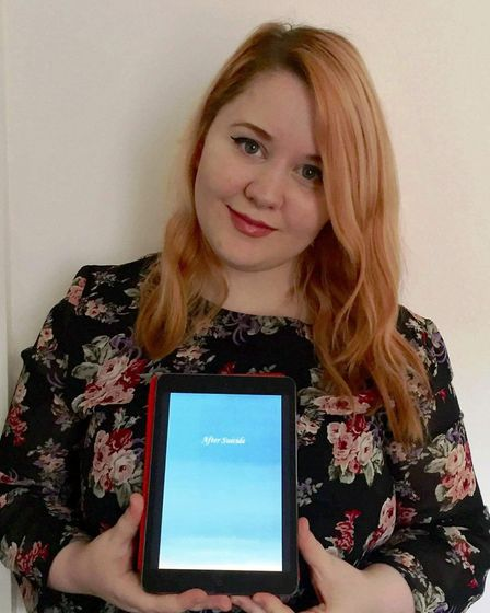 Charlotte Underwood with her e-book.
