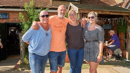 Ella Rowley (third from right) is the Landlady of the Robin Hood and Little John pub, and this is th