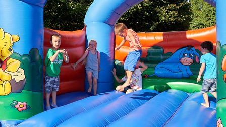 Children enjoying the bouncy castle, one of the many activities to keep them entertained and help ra