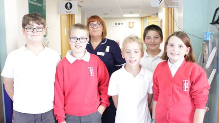Sister Jayne Miller, from the Queen Elizabeth Hospital in King's Lynn, with youngsters from Tilney S