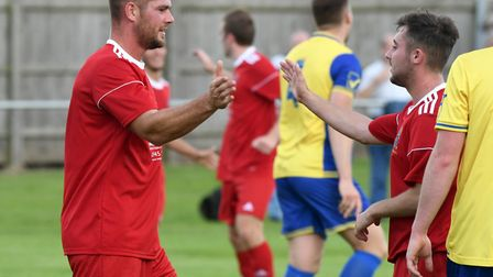 Josh Ford celebrates netting Wisbech's second goal against Wellingborough Town. PHOTO: Ian Carter