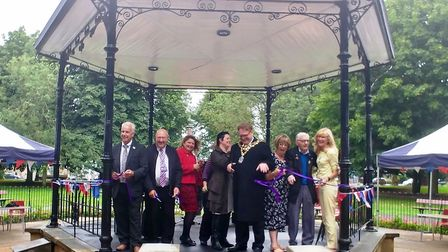 Cutting the ribbon to officially open the renovated bandstand are, from left, Bob Ollier (Fenland Di