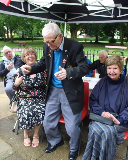 St Augustine's Day Care Centre user Arthur Hunt enjoys the music at the refurbished bandstand.