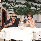 Arty and Shirley Achilleos decorated his garden to look like a holiday destination because he couldn
