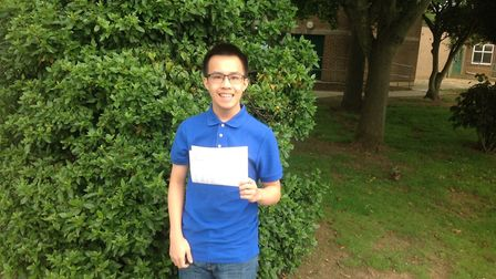 Isaac Cheng with his results at Stanborough Scool in Welwyn Garden City.
