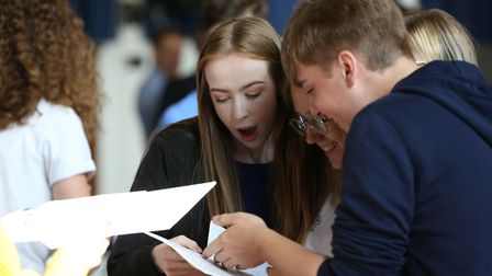 Pupils at Chancellor's School collect their GCSE results. Picture: Danny Loo