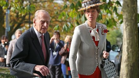 The Countess of Verulam escorts Prince Philip, the Duke of Edinburgh, into the opening of a new scie