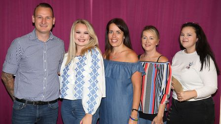 Pupils Chloe Hough (2nd left) and Lauren O'Donnell (right) with their family and GCSE results at Sir