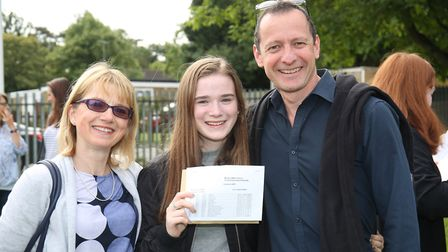 Monk's Walk School pupil Emma Kerr with her parents and GCSE results. Picture: Danny Loo