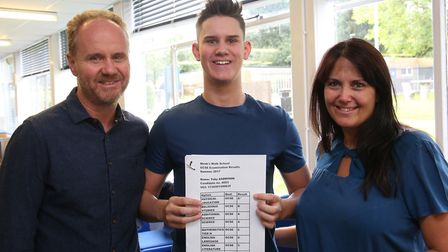 Monk's Walk School pupil Toby Addison with his parents John and Nicky and his GCSE results. Picture: