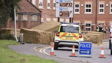 Churchill Road, Wisbech partially blocked after lorry crashes into lamp post leaving bales of hay in