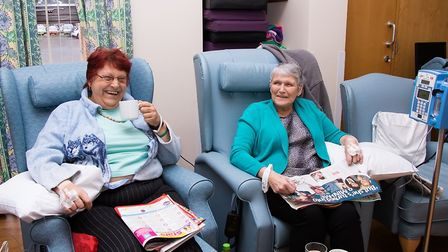 Carol Storey and Alma Graham enjoy a giggle and a cup of tea whilst receiving treatment in the loung
