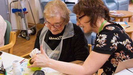 Phyllis Thornton (left), one of the Alan Hudson Day Treatment Centre's Day Therapy patients, takes p