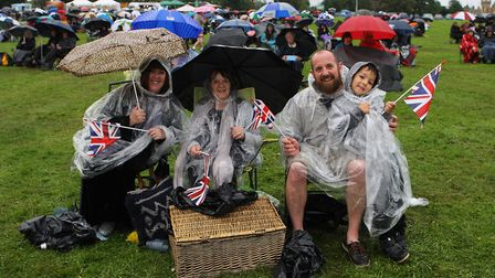 The Great British Prom 2017: The Karney family wrap up from the rain whilst enjoying the concert.